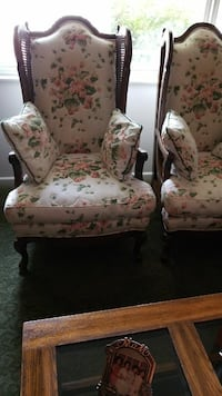 white and pink floral padded armchair