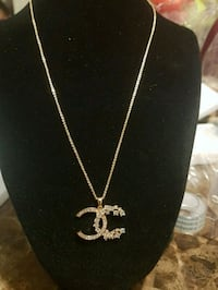 NEW, CHANEL  gold colored pendant necklace  London, N6K 2X6