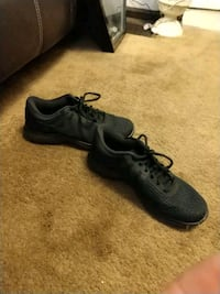 pair of black low top sneakers Indianapolis, 46219