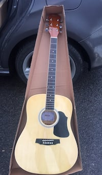 brown and black acoustic guitar with box Laval, H7G