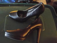 pair of black leather pumps