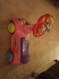 pink and purple Vtech ride-on toy