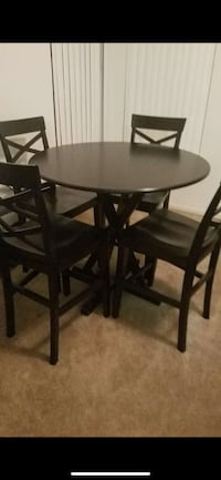 round black wooden table with four chairs dining set Sacramento, 95820