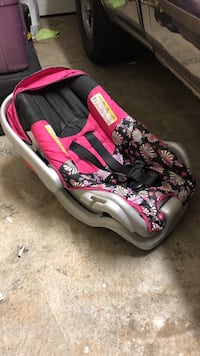 baby's black and pink floral car seat carrier