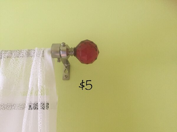 Curtain rod with pink gem finials