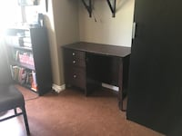 Black wooden single pedestal desk
