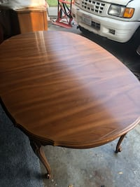 oval brown wooden dining table 2397 mi