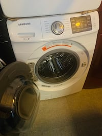 Samsung front load washer and dryer set working perfectly  Baltimore, 21223