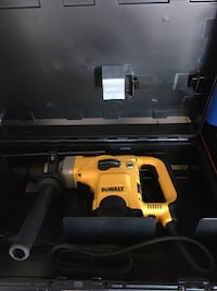 yellow and black DeWalt corded hammer drill with case