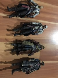 four Assassin's Creed character figurines