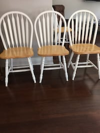 two white-and-brown wooden windsor chairs Laval, H7E 0A4