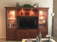 flat screen television with brown wooden TV hutch Scottsdale, 85255