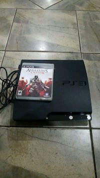 black Sony PS3 slim console with game case Queens, 11426