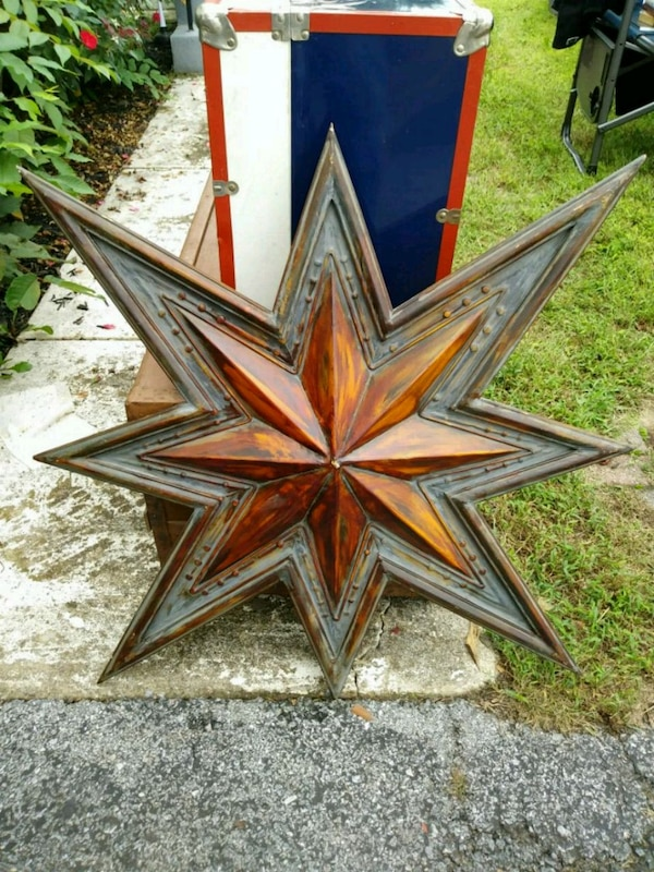 Large metal brown and red star decor