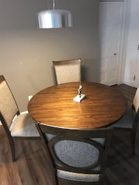 round brown wooden table with four chairs Québec, G1V 1V4