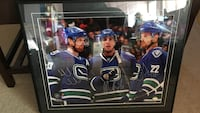 Canucks autographed photo. Sedins and burrows