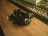 pair of studded black lace-up high-top sneakers