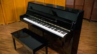 Pearl River (1988) black upright piano for sal Alexandria