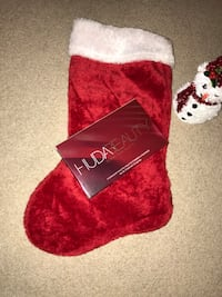 unpaired red and white Santa sock