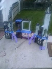white and purple plastic toy castle