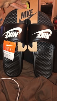 pair of black-and-white Nike slide sandals Melbourne, 32901