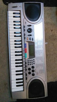 gray, black, and white electronic keyboard Center Cross, 22437