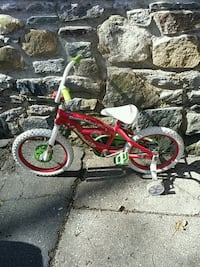 toddler's red and white bicycle