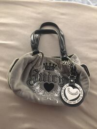 black and gray Juicy Couture tote bag