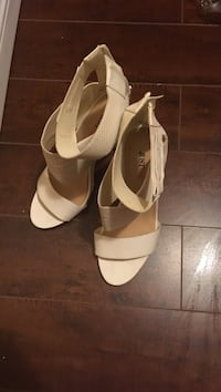 Pair of white leather ankle strap high heeled soes Brampton, L6P 1A8