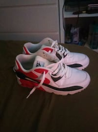 pair of white-and-red Nike running shoes