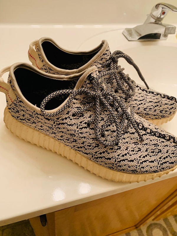 Pair of black and white adidas yeezy boost 350