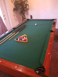 8ft pool table with cover.