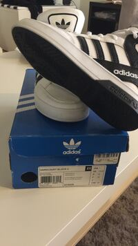Pair of black-and-white adidas high top sneakers with box Mississauga, L5B 1T1