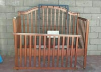 baby's brown wooden crib Los Angeles, 90061