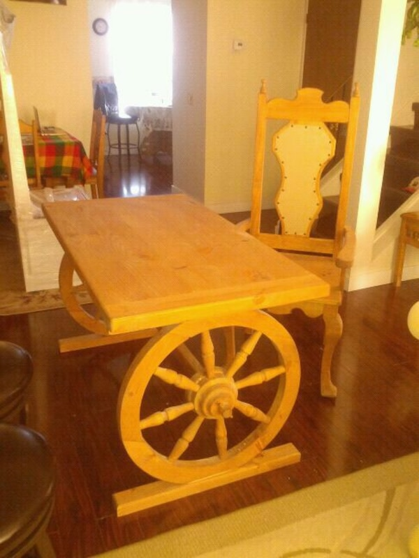 rectangular brown wooden table with chairs