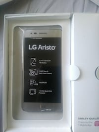 silver LG Aristo smartphone with box