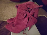pair of pink suede cork-heeled ankle boots