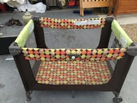 baby's black and yellow travel cot Las Vegas, 89178