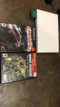 White ps2 slim with two good games in great condition and a 8 mb memory card  Santa Ana, 92703