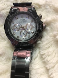 round black chronograph watch with silver link bracelet Nashville, 37211