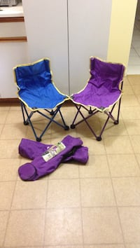 two blue and purple camping chairs