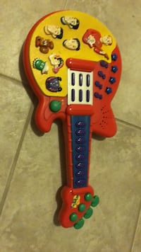 Like new Wiggles  guitar with batteries! Laval, H7Y 2C1