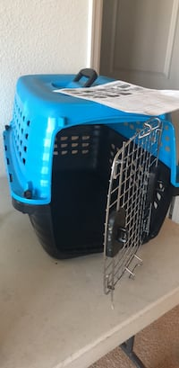 blue and black pet carrier 50 km
