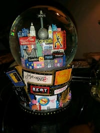 Rent snow globe, trade centers in it