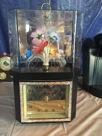 14 inch tall clock with light up, slow turn flowers. Calgary, T3E 4L3