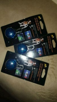 3 lighted dog tags.
