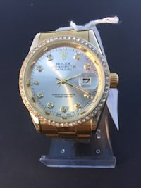round gold-colored Rolex analog watch with link bracelet 747 mi