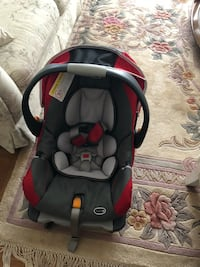 baby's black and red car seat carrier Burnaby