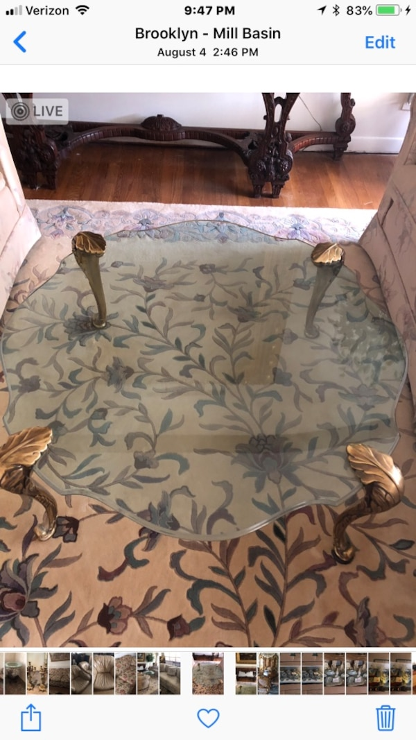 Curved bevelled edge glass coffee table with brass legs