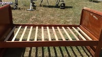 brown and white wooden bed frame Niles